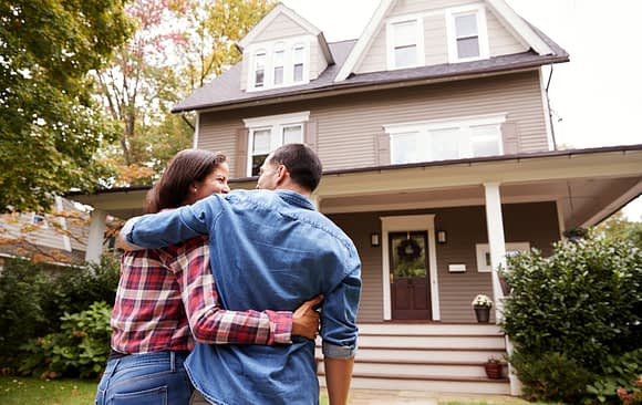 couple walking towards their newly purchased home