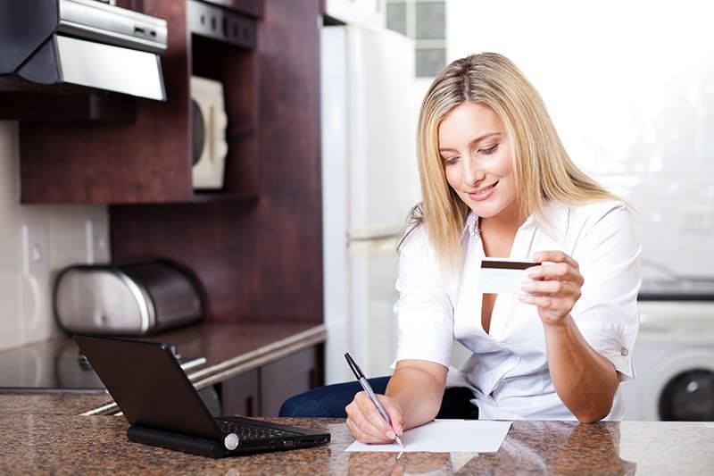 Woman doing money management paying bills