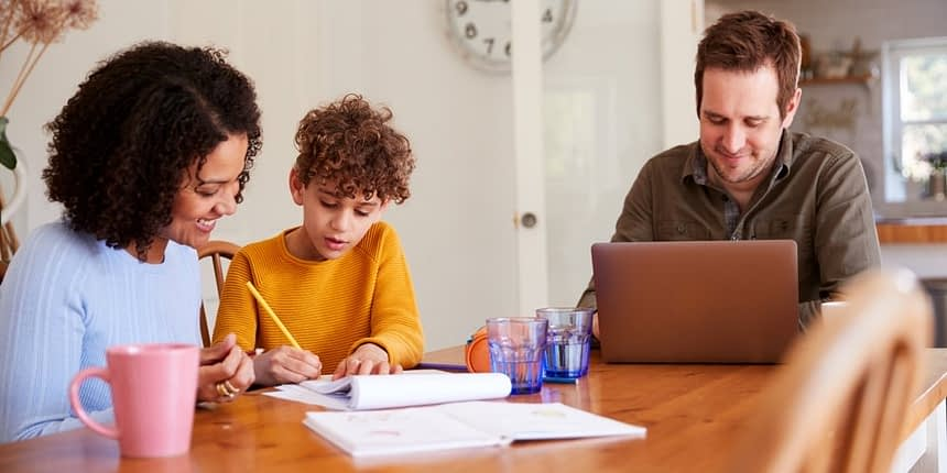 family working from home on dining room table