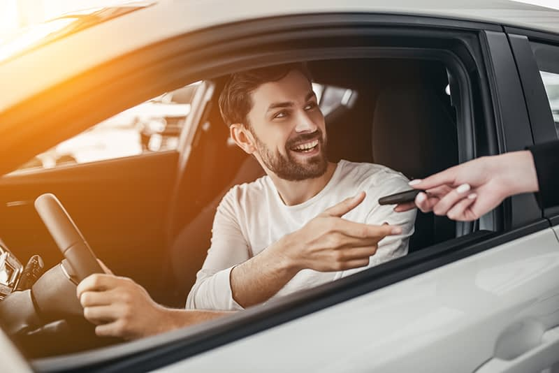 guy happy with new car purchase