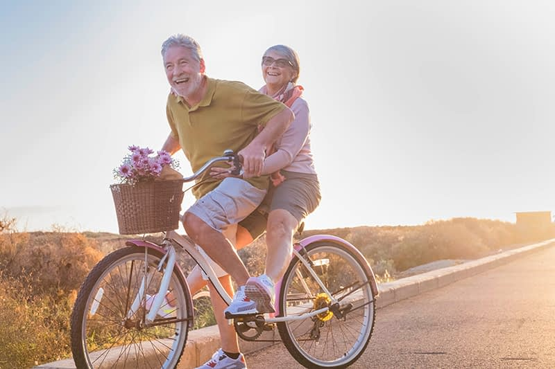 retired couple riding bike